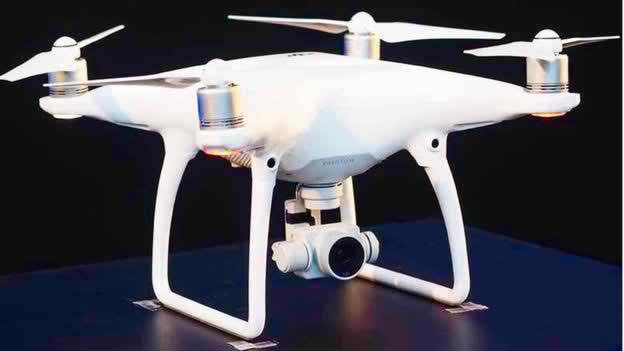 Held high-powered drone