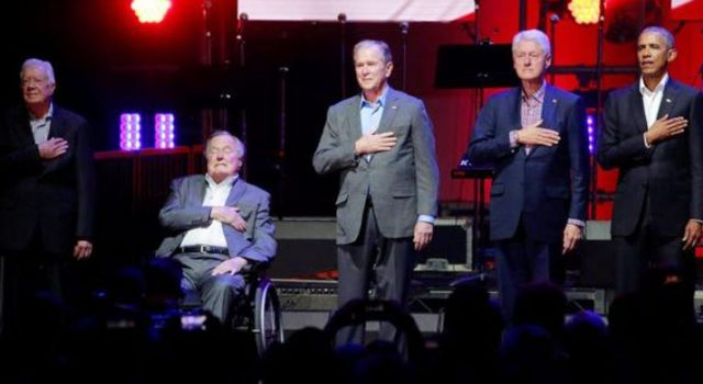 Five former US Presidents on a stage in relief collection for victims of cyclone victims